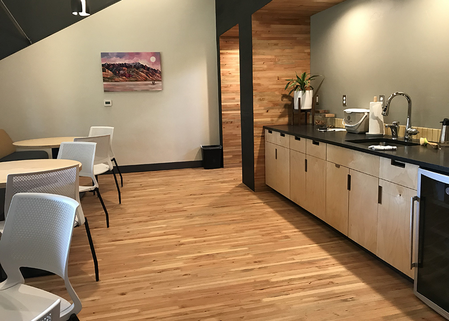 The large break room featuring nail laminated time floors and wall accents