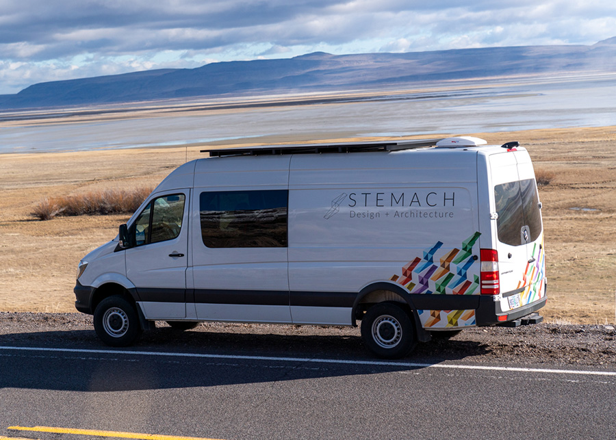 An exterior view of the van with the Stemach Design logo painted along the side